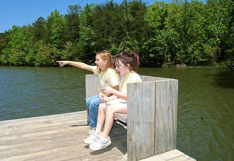 2 girls enjoying the lake at Madison County Nature Trail South Huntsville